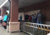 Churchgoers gather for song and prayer outside grocery store during Hurricane Florence