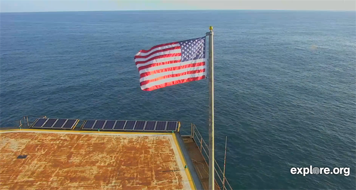 A new flag has been raised in front of the Frying Pan Tower cam, relieving the former Old Glory that survived brutal winds from Hurricane Florence. (Source: Explore.org/YouTube)
