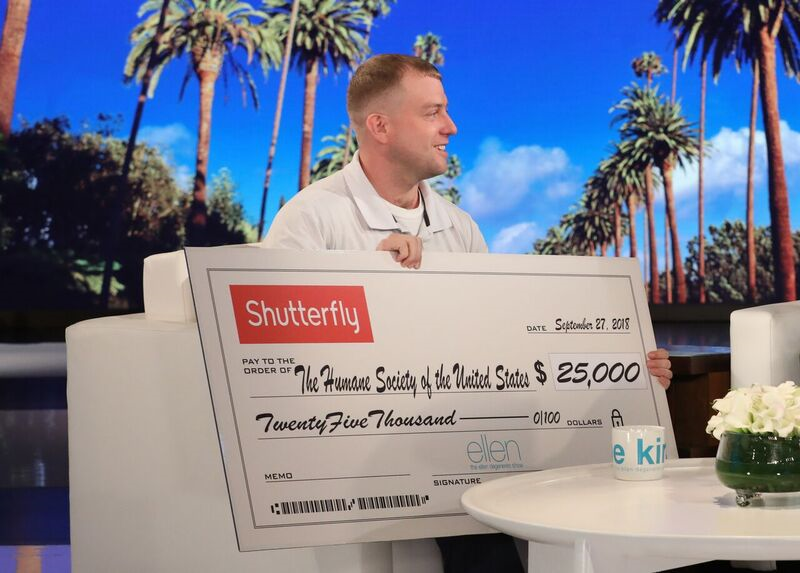 Ryan Nichols holds a $25,000 check for the Humane Society to be donated in his name. (Source: Warner Bros.)