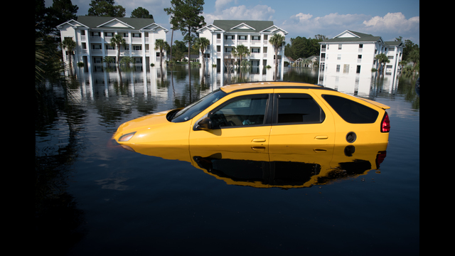 A car is inundated with floodwaters caused by Hurricane Florence at an apartment complex at Aberdeen Country Club in Longs, South Carolina. Floodwaters are expected to rise through the weekend in the area. (Photo by Sean Rayford/Getty Images)