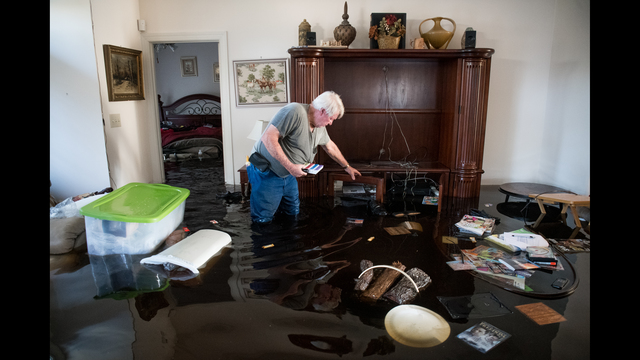Billy Hardee removes valuables from his home as floodwater caused by Hurricane Florence rises at Aberdeen Country Club in Longs, South Carolina. Floodwaters are expected to rise through the weekend in the area. (Photo by Sean Rayford/Getty Images)