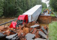 Crumbling road swallows up truck, car in hurricane-battered SC county