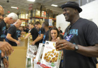 Hornets owner Michael Jordan and team pack food boxes for Florence victims