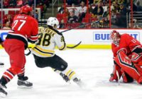 Marchand, Bruins stop Hurricanes 3-2