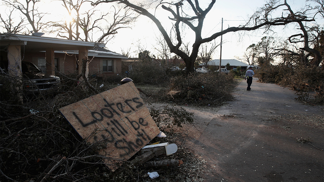 A search and rescue team member walks down a street with homes damaged by Hurricane Michael on October 14, 2018 in Panama City, Florida. (Photo by Scott Olson/Getty Images)