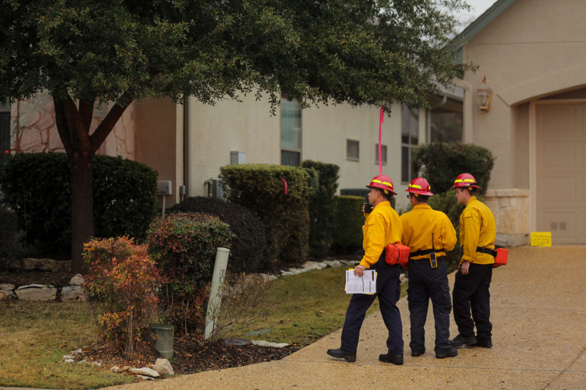 Firefighters survey a scene during the simulated training session.