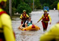 Australian leader tours floods where 2 men reported missing