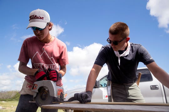Hudson McLeod, left, 14, of Round Rock, and Marshall Roberts, 19, of Wichita Falls, cut siding on the side of a home that was damaged during Hurricane Harvey in Aransas Pass on Wednesday, July 10, 2019. They were a few of several students from middle school to college who were participating in a BOUNCE mission which offers students an opportunity to help communities dealing with long-term disaster recovery.