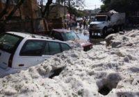 Freak summer hailstorm blankets Mexican city in ice