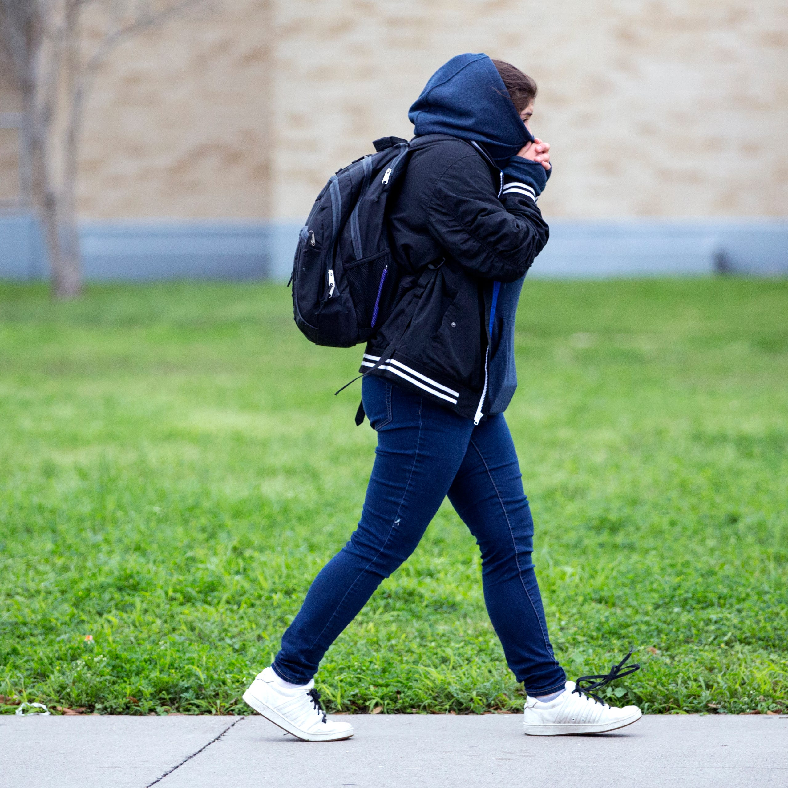 A Ray High School student walks to school on Monday, March 4, 2019. After a strong cold front moved into the Corpus Christi area Sunday afternoon, temperatures were in the upper 30s Monday morning with wind chills in the 20s.