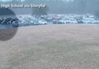 Surveillance video shows tornado flipping cars in South Carolina high school parking lot