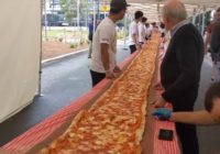 Australian restaurant bakes pizza longer than a football field to raise money for firefighters battling wildfires