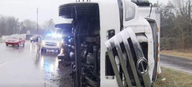Mail truck blown onto it side by powerful winds