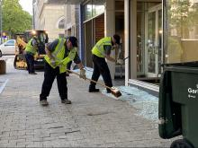 Clean-up crews are downtown Raleigh sweeping up broken glass off the streets.