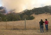 California wildfires burn down buildings, prompt evacuations