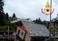 Mountain flooding kills 2 in Italy, traps dozens in France