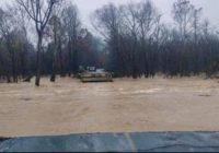 Flooding in North Carolina foothills covers buildings, cars