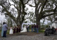 Hurricanes, virus can't stop Louisiana couple's wedding