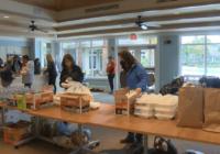 Volunteers help tornado victims recover