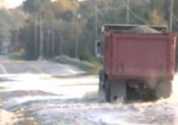 'Hope and pray for the best.' Small eastern North Carolina town fights flooding