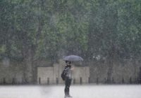 London cleans up after flash flooding drenches homes, subway