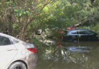 At least five cars stuck in Olmos Creek after Orsinger Lane floods